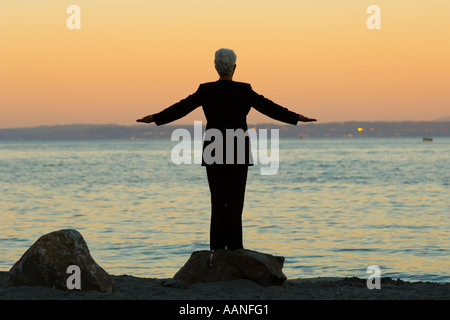 a woman embraces the morning - Stock Photo