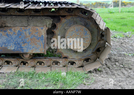 Rusted and bent caterpillar track on construction equipment - Stock Photo