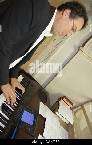 man playing on synthesizer - Stock Photo