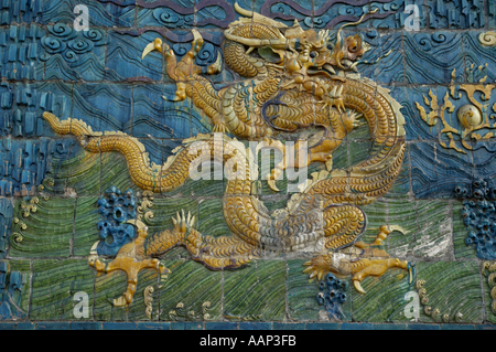 Ornate and decorative Chinese dragon painting on the Nine Dragon Screen in Datong, Shanxi, China. - Stock Photo