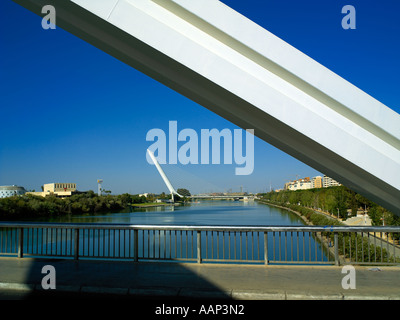 The modern bridges now linking Seville with the island of Cartuja across the Guadalquivir river - Stock Photo