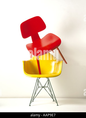 Designer chairs stacked on top of each other - Stock Photo