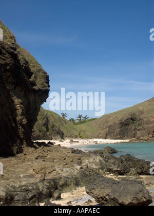 One of the hidden deserted beach coves at Tanjung Aan with its strange rock formations Kuta Lombok Indonesia - Stock Photo