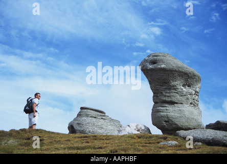 Walking amongst rock formations in the Bucegi mountains Romania - Stock Photo
