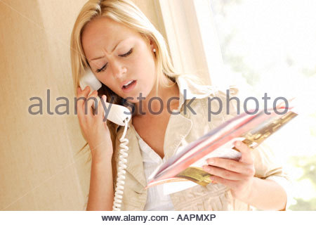 Woman on telephone complaining - Stock Photo