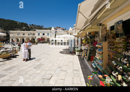 Couple with Guidebook outside shop in St Mark's Square (Aghios Markou Sq), Zakynthos Town, Zakynthos, Ionian Islands, - Stock Photo