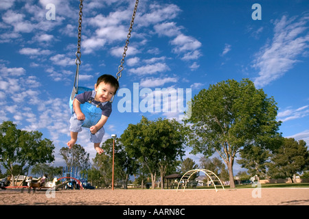10 Month Old Baby Playing In Swing At Public Park Mesa Arizona USA