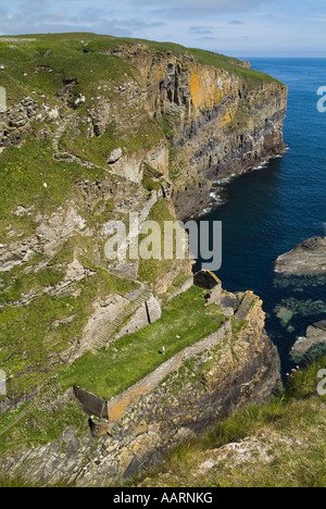 dh  WHALIGOE CAITHNESS Steep stone steps to cove harbour carved out of seacliff and tourist