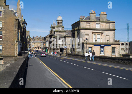 dh  WICK CAITHNESS People walking down Bridge Street town centre buildings road north 500 - Stock Photo