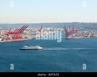 Washington State Ferry Sails Past The Shipyards in Seattle Washington Transporting Passengers and Vehicles - Stock Photo