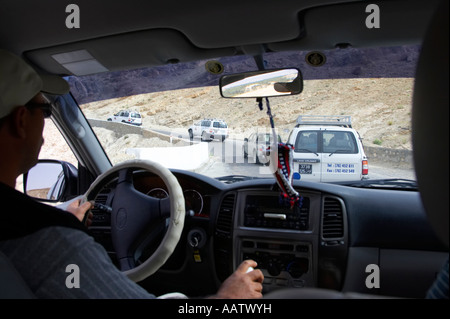 group of off road vehicles negotiate tight twisty mountain pass roads in the mountains tunisia - Stock Photo