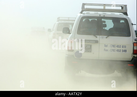 off road convoy driving through the north african desert in tunisia - Stock Photo