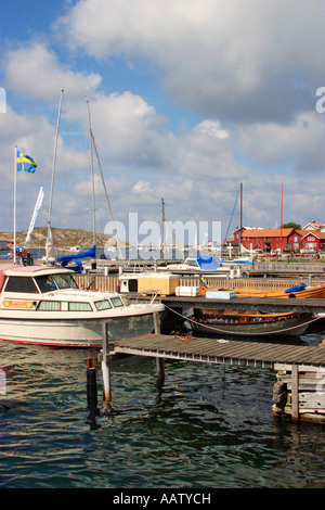 motorboat at the bridge in the fishing village - Stock Photo