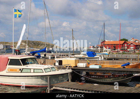 Boat at the bridge in the fishing village - Stock Photo
