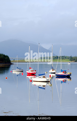 Five sailing boats on Loch Leven near Ballachulish Glencoe with road bridge and mountainous backdrop - Stock Photo