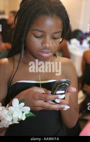 Hialeah Florida Gardens Non Violence Project USA End of Year Awards Ceremony Black female student cellular phone - Stock Photo