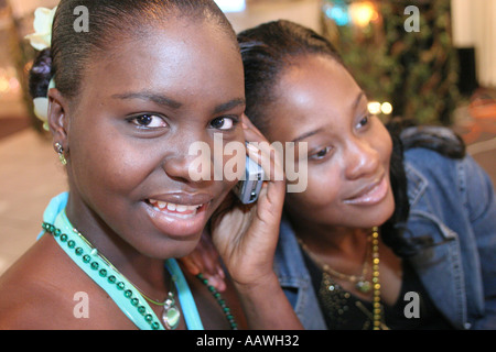 Hialeah Florida Gardens Non Violence Project USA End of Year Awards Ceremony Black female students cellular phone - Stock Photo