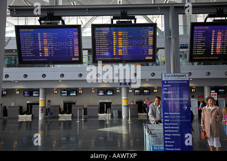 Arrival departure board at the EuroAirport Basel-Mulhouse-Freiburg in France. - Stock Photo