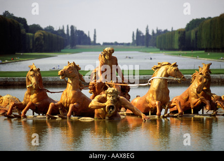 Fountain of Apollo and the Grand Canal at the Palace of Versailles, France - Stock Photo