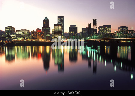 Skyline of Portland Oregon seen across the Willamette River with The Hawthorne Bridge at sunset - Stock Photo