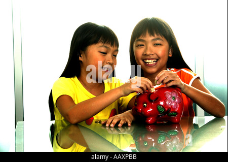 Twin with Piggy Bank - Stock Photo