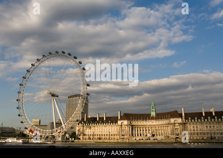 The world famous Millennium Wheel, the London Aquarium and the Thames on a cloudy day. - Stock Photo