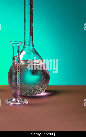 Clear Glass Beaker Vial With Bubbles In Liquid In Research And Science Development Lab Laboratory, USA - Stock Photo