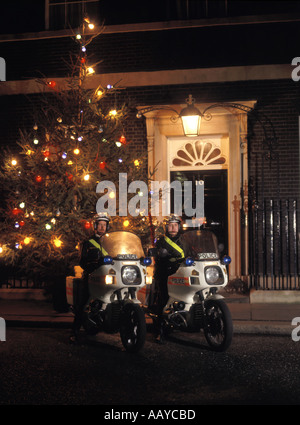 Number ten Downing street front door official residence of British Prime Minister police motorcyclists & Christmas - Stock Photo