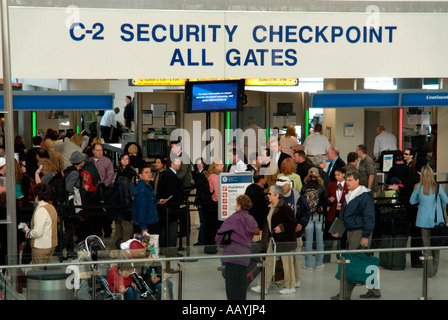 People waiting in line at airport security checkpoint, Newark International Airport, North America - Stock Photo