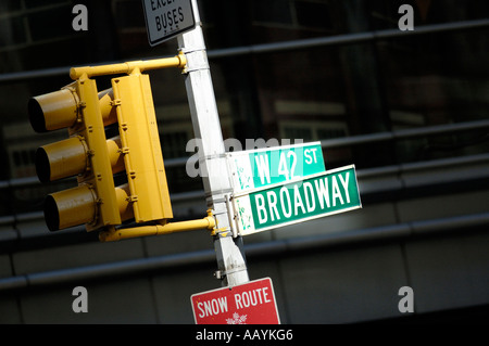 Street signs spotlit by sun at intersection of Broadway and Forty Second 42nd street, Times square, New York City - Stock Photo
