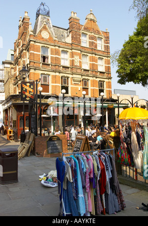 the Camden Head pub in Islington and street market in Camden Walk - Stock Photo