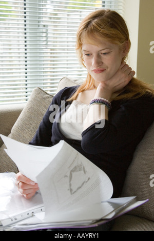 A women with paperwork at home - Stock Photo