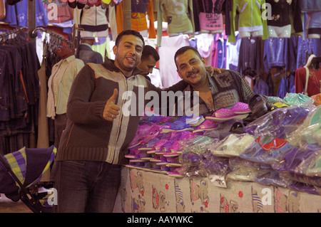Portrait two men by stall at night market in old town Ed Dahar region Hurghada Egypt - Stock Photo