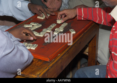 Hands of men playing dominoes - Stock Photo