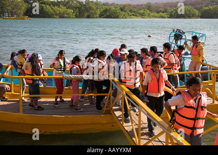 Children disembarking from boat, Sumidero Canyon trip, Rio Grijalva, near San Cristobal de las Casas, Mexico - Stock Photo