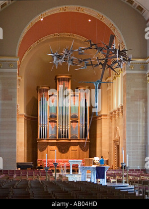 Organist practices at the altar of St John the Divine Cathedral in Milwaukee Wisconsin - Stock Photo