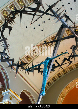 Crucifix suspended from the ceiling of Saint John the Divine Cathedral, Milwaukee WI - Stock Photo