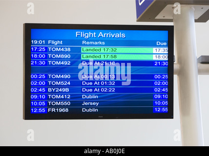 Flight Arrivals electronic notice board at a small UK Airport - Stock Photo