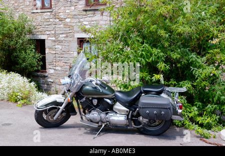 Harley Davidson parked outside a cottage in Hay on Wye Powys Wales UK - Stock Photo