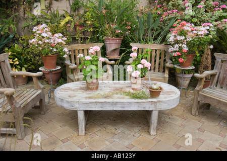 Wooden Garden Furniture on Patio UK Norfolk - Stock Photo