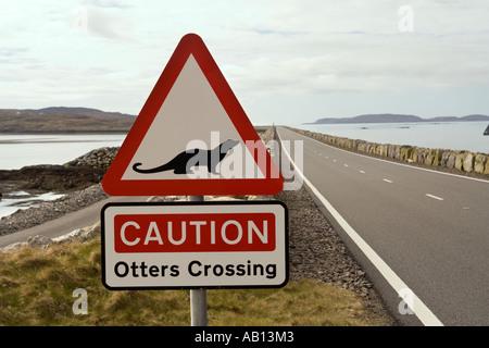 UK Scotland Western Isles Outer Hebrides Eriskay causeway beware otters crossing warning sign - Stock Photo