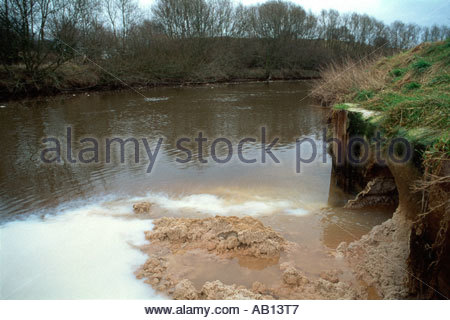 Pollution in the River Weaver caused by outflow from chemical works Northwich Cheshire - Stock Photo
