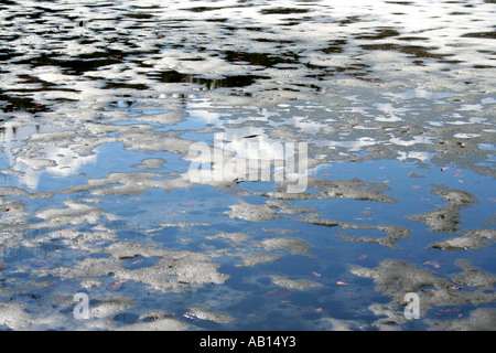 spring melt pattern on a lake in Bavaria Germany - Stock Photo
