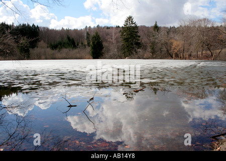 Spring break up and ice thawing on a lake in Bavaria Germany - Stock Photo