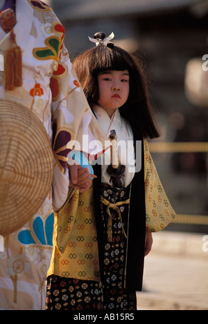 Young girl dressed as a Samurai warrior the the Festival of the forty seven samarai in Ako Japan - Stock Photo