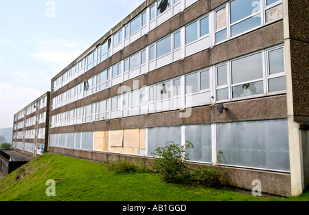 Derelict block of flats with smashed and boarded up windows in Ebbw Vale Blaenau Gwent South Wales Valleys UK - Stock Photo