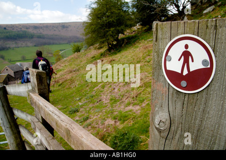 CROW Countryside and Rights of Way sign on footpath with people walking in Vale of Ewyas Monmouthshire South Wales - Stock Photo