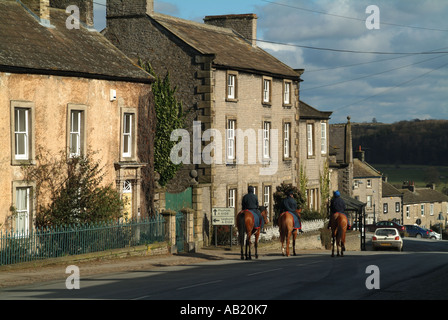 Race horses returning from the gallops in the town of Middleham, North Yorkshire - Stock Photo