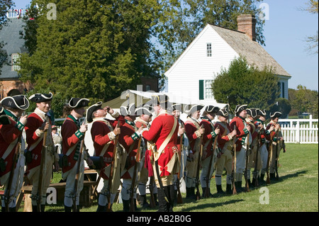 British soldiers toast to the King of England in front of the Digges House built in 1775 in Yorktown Virginia First - Stock Photo