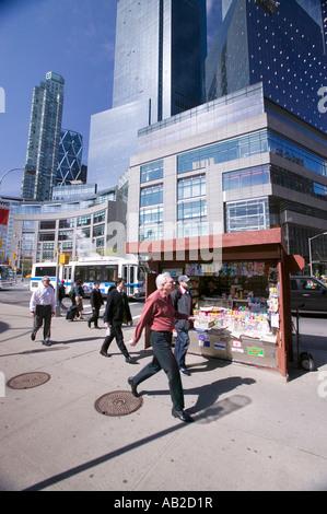 Man walks by magazine stand near Columbus Circle in Manhattan New York City New York - Stock Photo